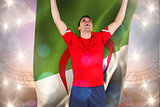 Composite image of excited football player cheering holding algeria flag
