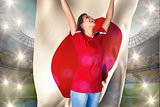Composite image of cheering football fan in red holding japan flag
