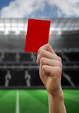Composite image of hand holding up red card