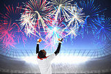 Composite image of excited goalkeeper in white cheering