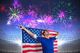 Composite image of american soccer fan holding flag