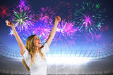 Composite image of pretty football fan in white cheering
