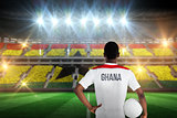 Composite image of ghana football player holding ball