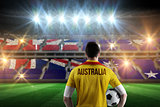 Composite image of australia football player holding ball
