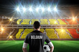 Composite image of belgium football player holding ball