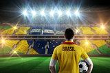 Composite image of brasil football player holding ball