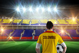 Composite image of colombia football player holding ball