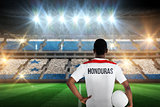 Composite image of honduras football player holding ball