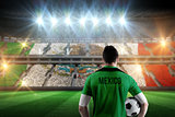 Composite image of mexico football player holding ball