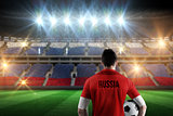 Composite image of russia football player holding ball