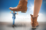 Composite image of cowboy boots stepping on girl
