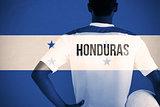 Composite image of honduras football player holding ball