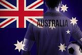 Composite image of australia football player holding ball