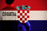 Composite image of croatia football player holding ball
