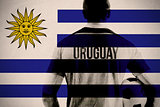 Composite image of uruguay football player holding ball