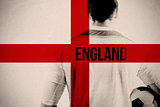 Composite image of england football player holding ball