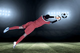 Composite image of goalkeeper in red making a save