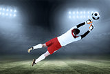 Composite image of goalkeeper in white jumping up