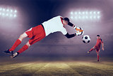 Composite image of fit goal keeper jumping up