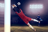 Composite image of goalkeeper in red jumping up