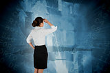 Composite image of young businesswoman standing and looking
