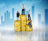 Composite image of business people on pile of coins