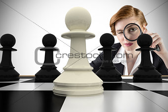 Composite image of focused businesswoman with magnifying glasses