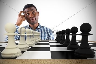 Composite image of thinking casual businessman