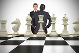 Composite image of businessmen and chess pieces