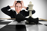Composite image of stressed businesswoman with hands on her head