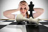 Composite image of stressed businesswoman with hands on head