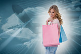 Composite image of a woman carrying shopping bags
