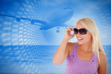 Composite image of blond woman with sunglasses