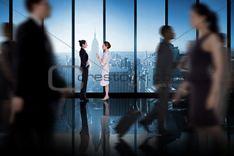 Composite image of businesswomen talking