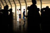 Composite image of silhouette of business people walking