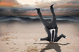 Composite image of businessman burying his head