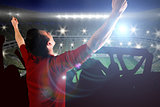 Composite image of cheering football fan in red jersey