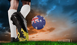 Composite image of football boot kicking australia ball