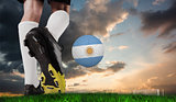 Composite image of football boot kicking argentina ball