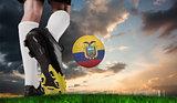 Composite image of football boot kicking ecuador ball