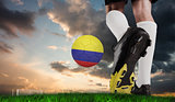 Composite image of football boot kicking colombia ball
