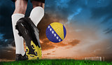 Composite image of football boot kicking bosnia ball