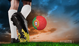 Composite image of football boot kicking portugal ball
