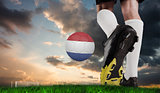 Composite image of football boot kicking dutch ball