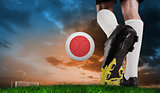 Composite image of football boot kicking japan ball