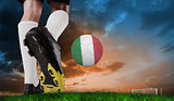 Composite image of football boot kicking italy ball