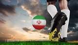 Composite image of football boot kicking iran ball