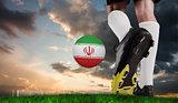 Composite image of football boot kicking iran ball