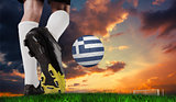 Composite image of football boot kicking greece ball