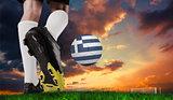 Composite image of football boot kicking greece ball